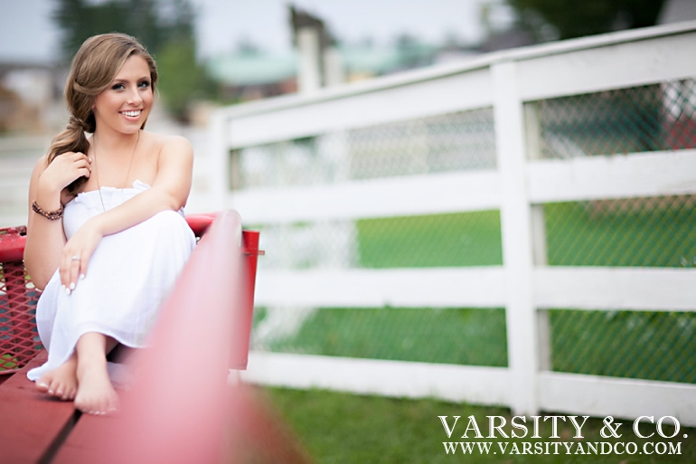 girl in a wagon senior picture